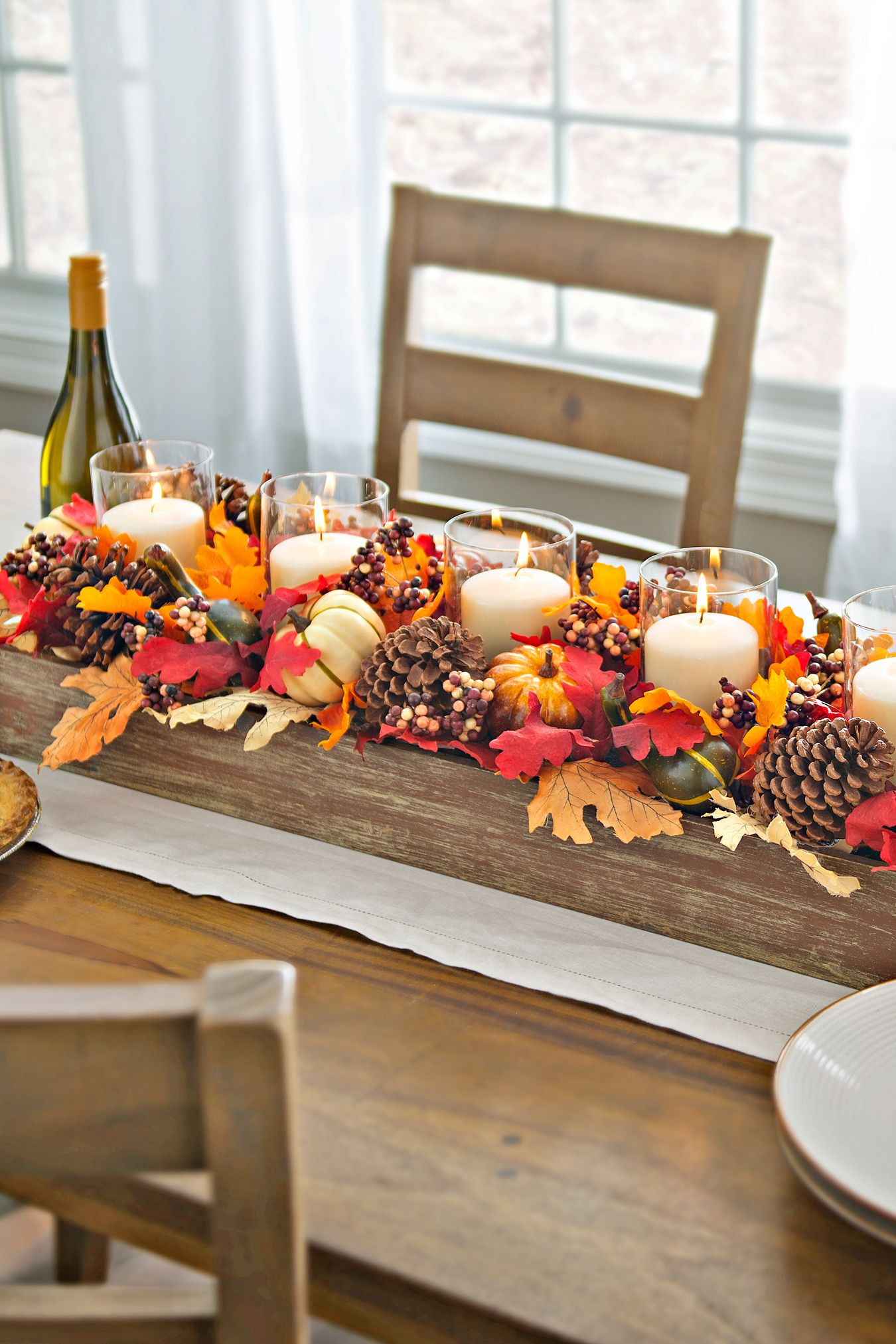 Autumn table centerpiece with pinecones and foliage