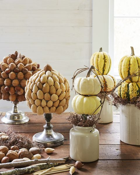 tabletop topiaries made with mini pumpkins and nut covered craft balls