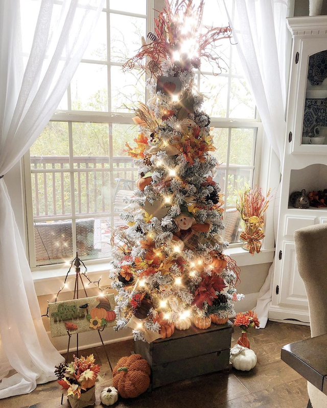 fall christmas tree decorated with pumpkins and leaves and scarecrow dolls