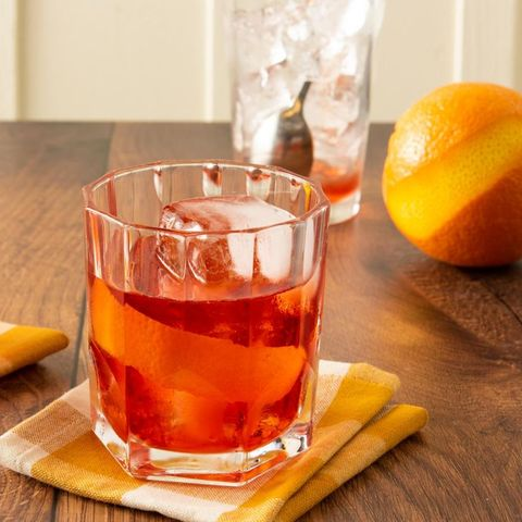 negroni with orange and glass of ice