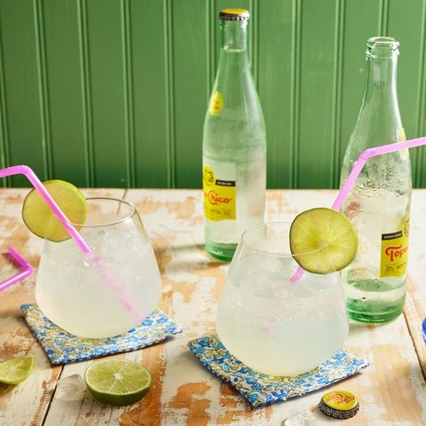 ranch water with limes and topo chico bottles
