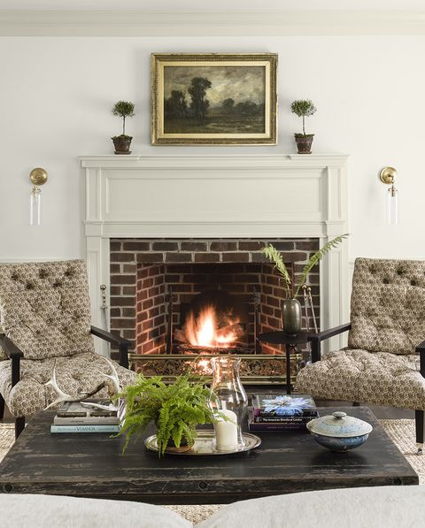 colonial revival home designed by lauren liess living room, sitting area, fireplace