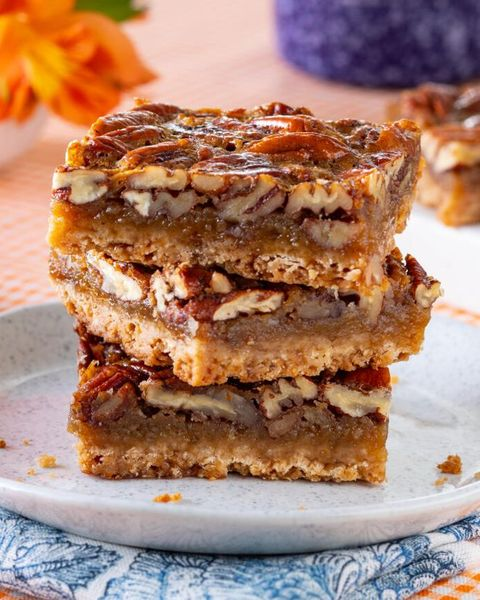 pecan pie bars stacked on plate