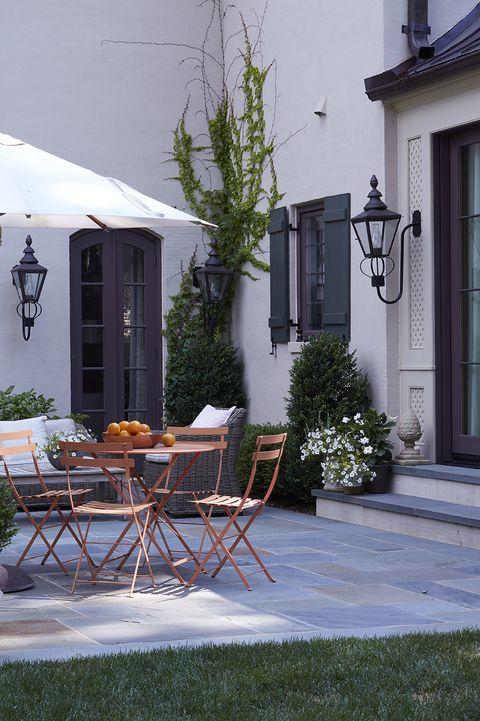 porch with orange patio furniture