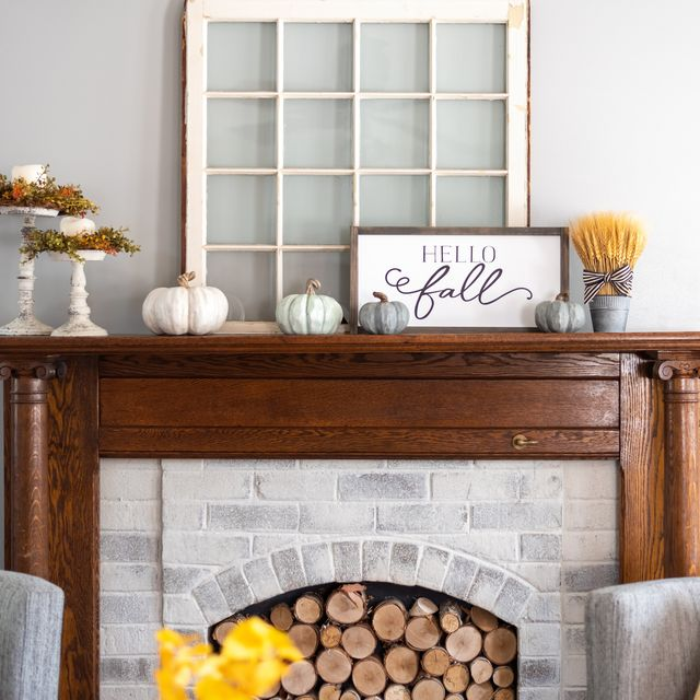 stylish fall decorations on the mantel at home