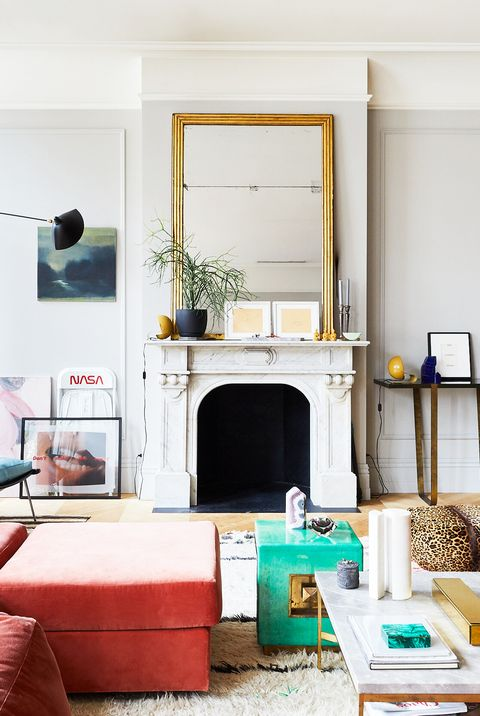 living room with mirror leaning on mantel