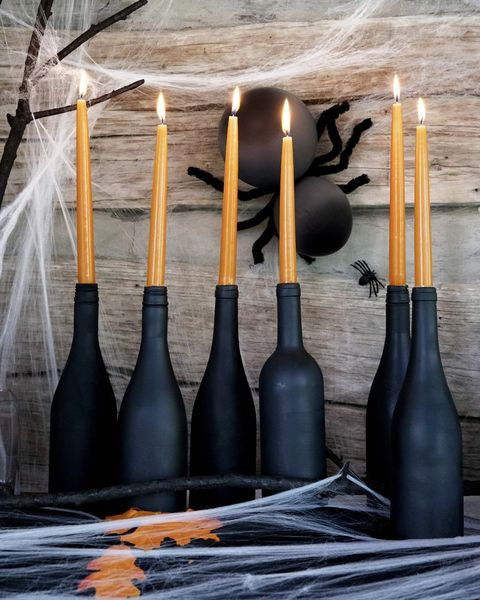 fall mantel with spiders and black wine bottles