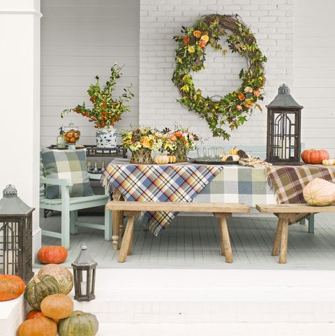 the back porch of a rancher home transformed by georgia designer james farmer is decorated for fall