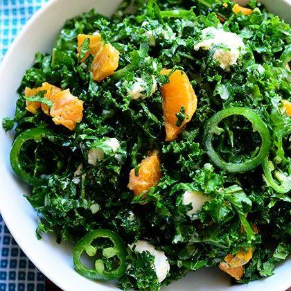 kale citrus salad with blue napkin