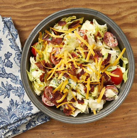 ranch chopped salad in black bowl with blue and white napkin