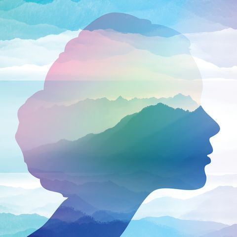 woman's profile overlapped with watercolor landscape