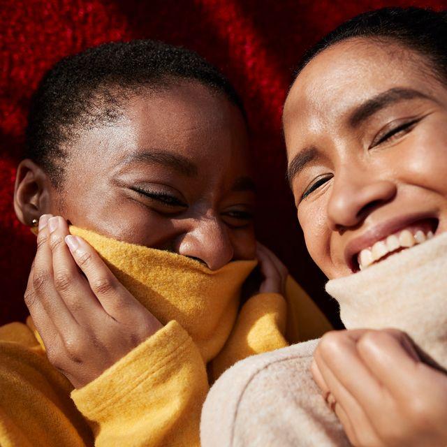two women in turtleneck sweaters