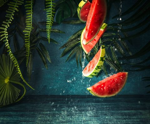 falling watermelon pieces with water splash