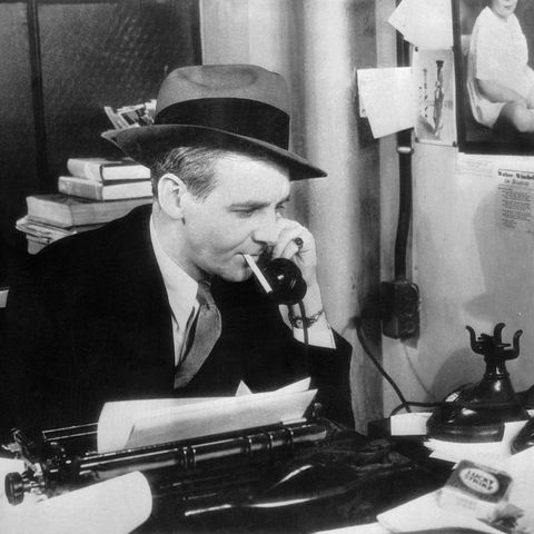 Walter Winchell Talking on Telephone in His Office