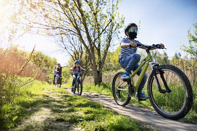 family enjoying a bike trip during covid 19 pandemic