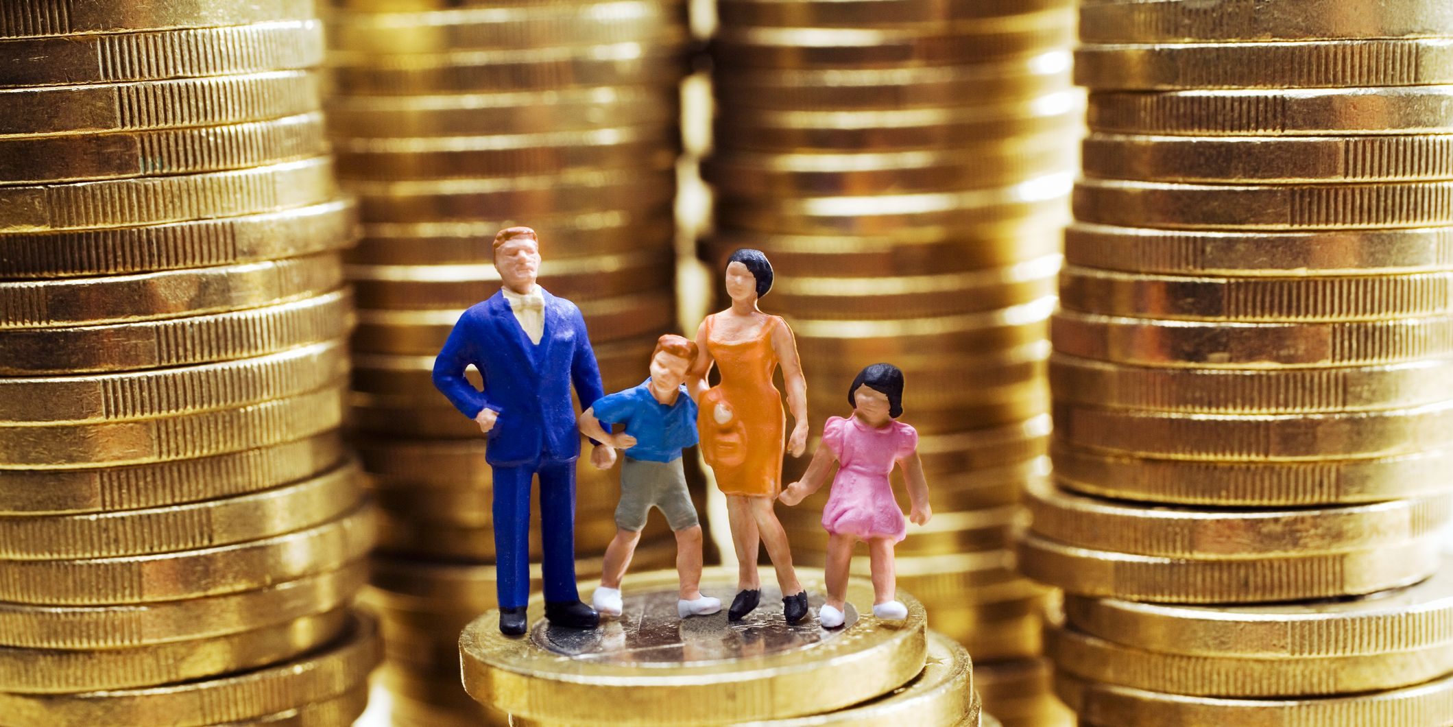 Family figurines on stack on Euro coins