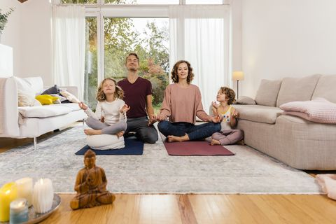 family meditating together at home