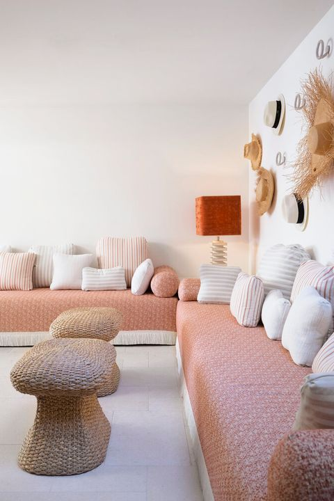 family room with peach sofa and hat gallery wall
