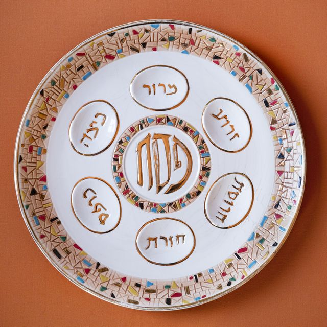 a family seder plate laid out for passover