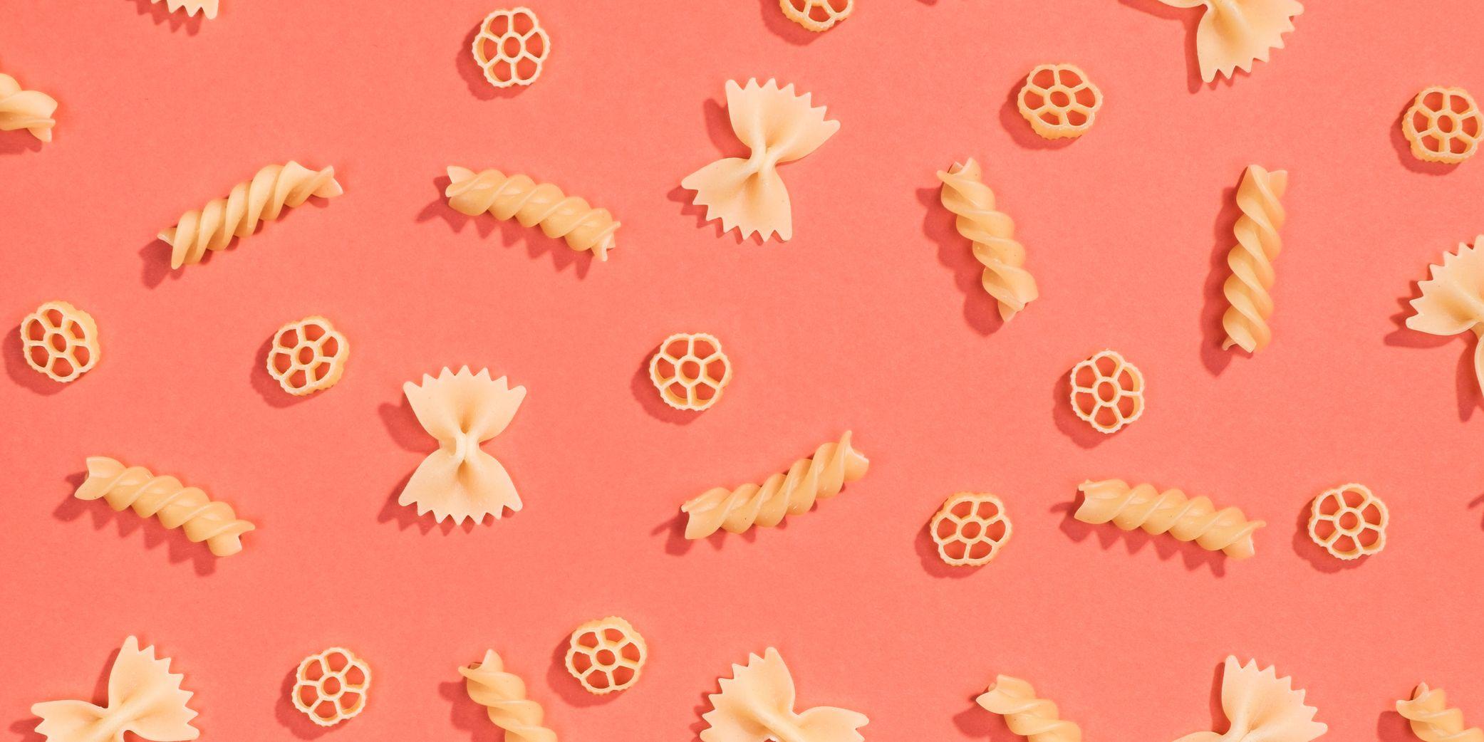 Farfalle, rotelle and fusilli pasta flat lay