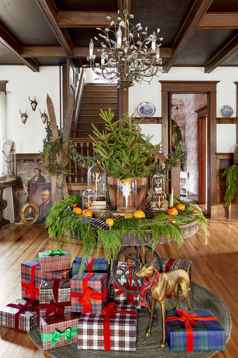 christmas entryway table with plaid paper wrapped gifts