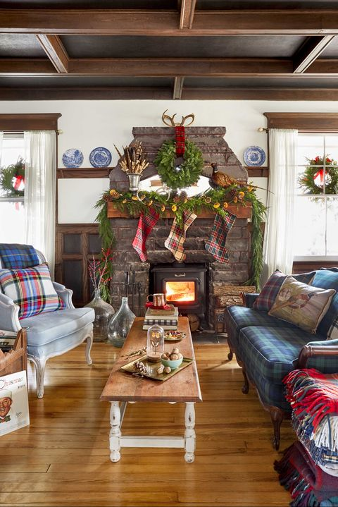 christmas farmhouse living room with stone fireplace