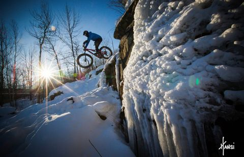 A rider drops in on lift-served winter fat bike trails at Duluth, Minnesota's Spirit Mountain.