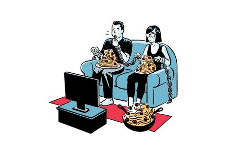 Couple eating in front of the TV