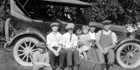 Dad and the all the kids with the family car, ca. 1928.