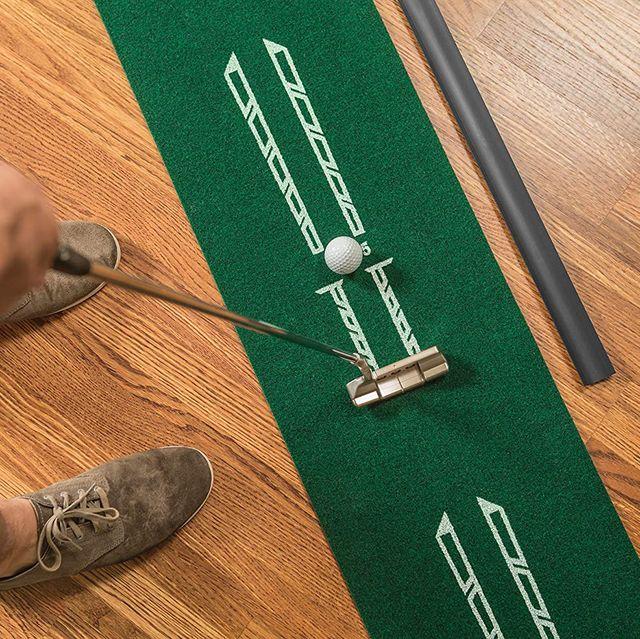 golfer putting on indoor green