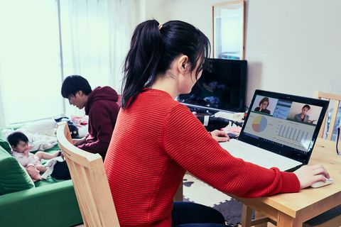 father takes care of daughter and mother is busy working from home