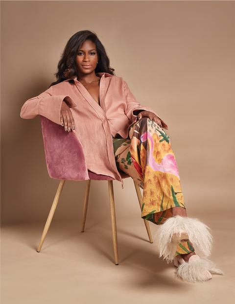 Clothing, Pink, Fashion, Textile, Silk, Outerwear, Fashion design, Sitting, Photo shoot, Magenta,