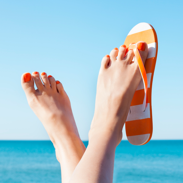 bare feet in sandals at beach