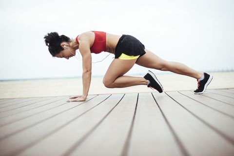 Female athlete doing morning exercise routine