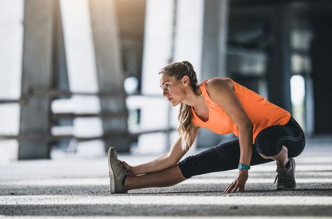 Female Athlete Stretching Outdoors