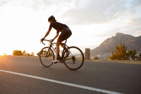 Female cyclist riding early in the morning