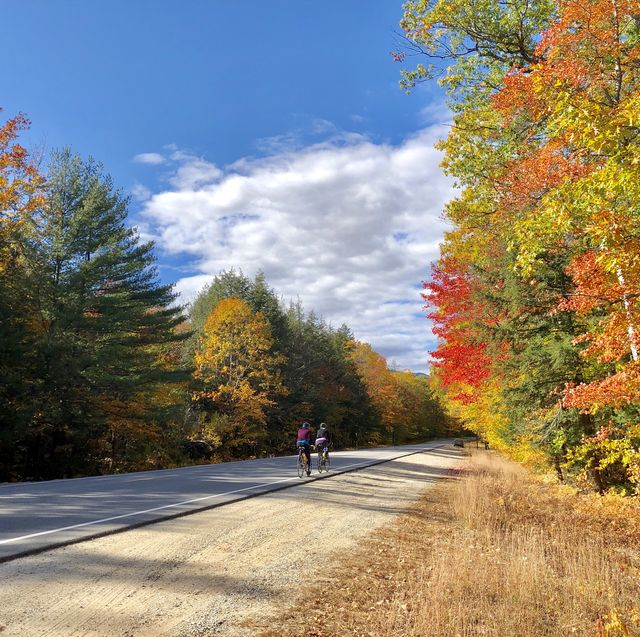 female cyclists on the kancamagus highway near conway, new hampshire usa during autumn