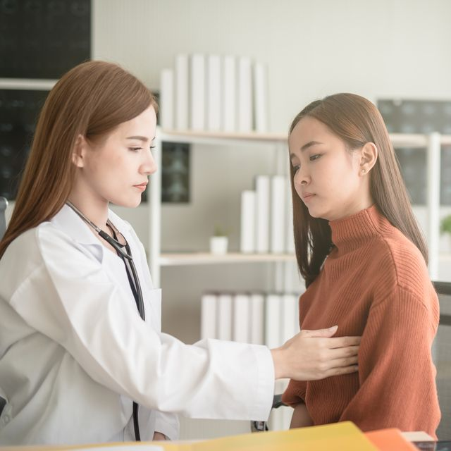 female doctor examining patient in hospital