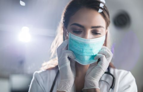Female doctor with protective mask