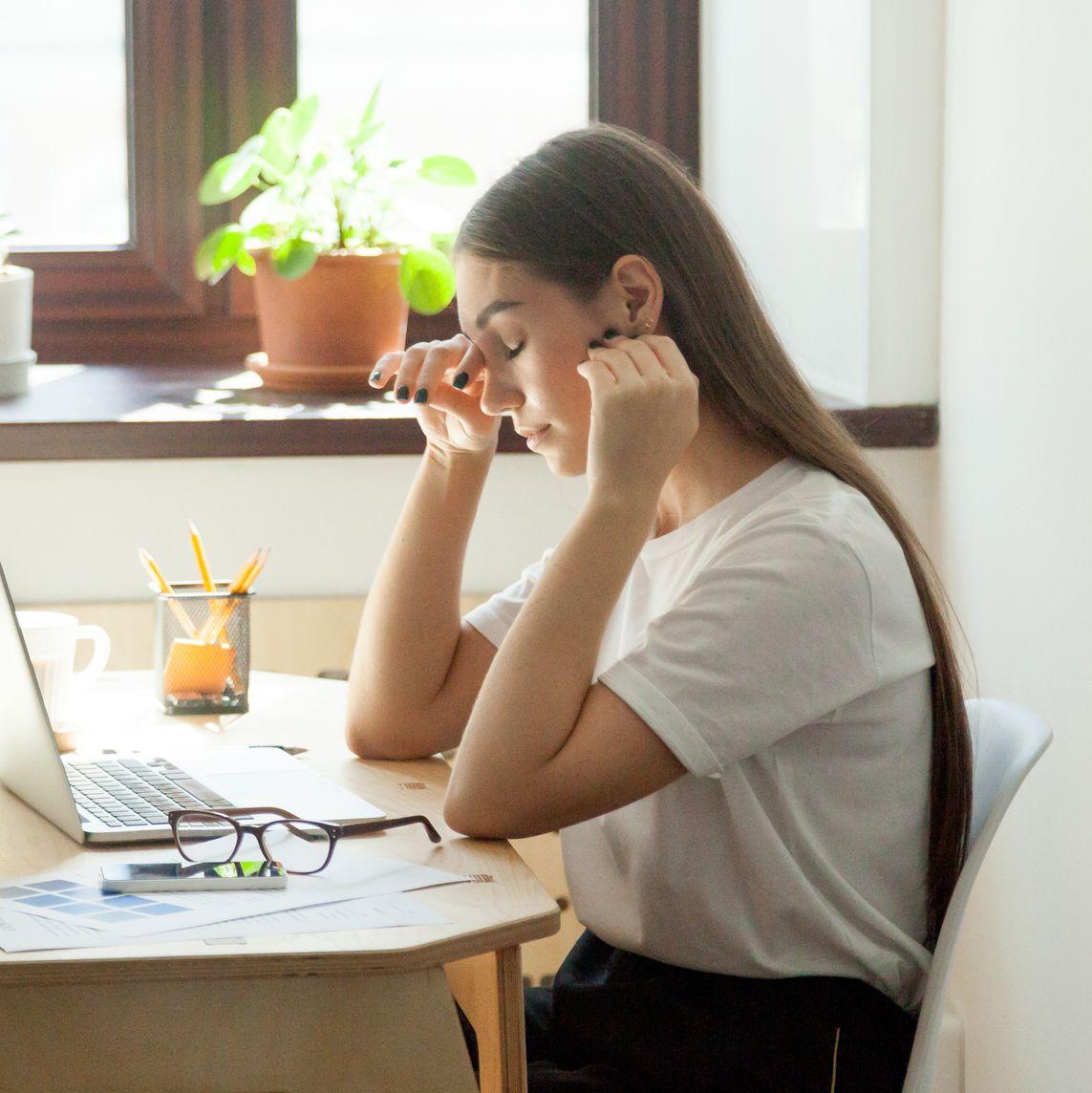 Female employee taking a minute break resting her eyes.