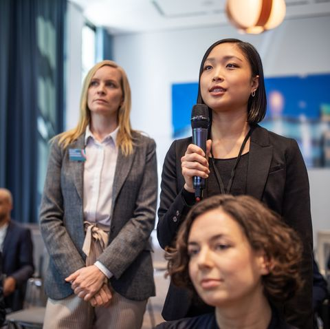 female executive asking some questions during a launch event