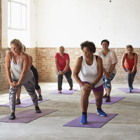 female fitness trainer leading a class at the gym