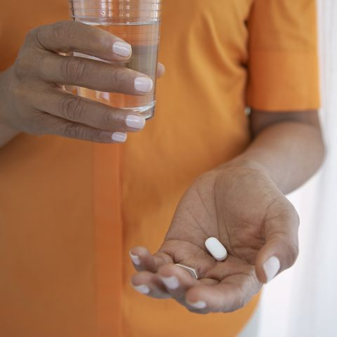 female hands with pill