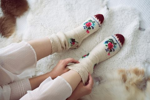 female legs in knitted socks