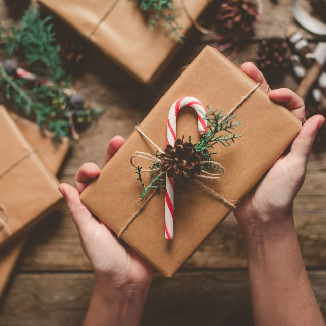 Female person holding Christmas gift