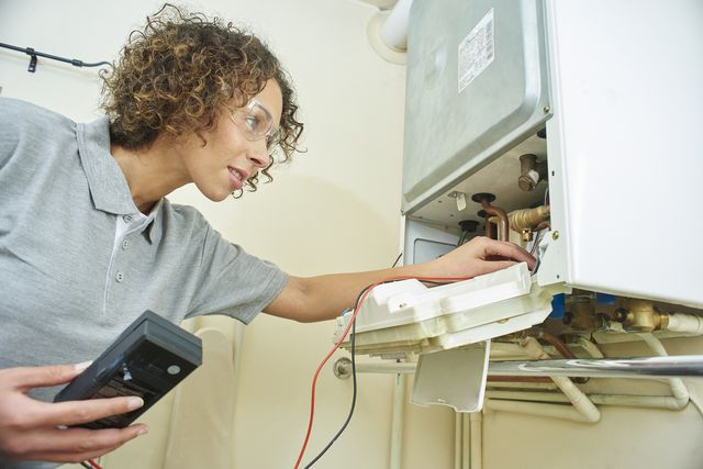 female plumber with central heating