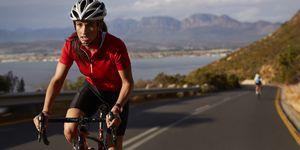 Female pro cyclist taking lead on mountain climb