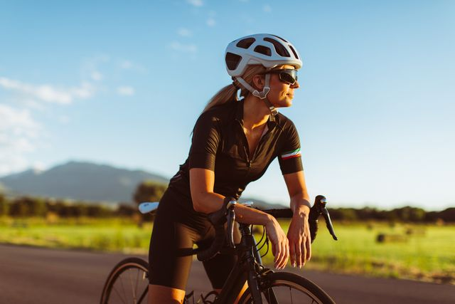 female riding road bike in summer