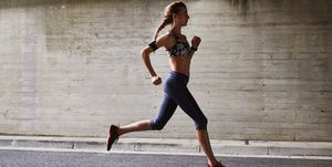 Female runner running on urban street