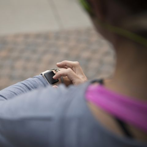 Female runner using smart watch